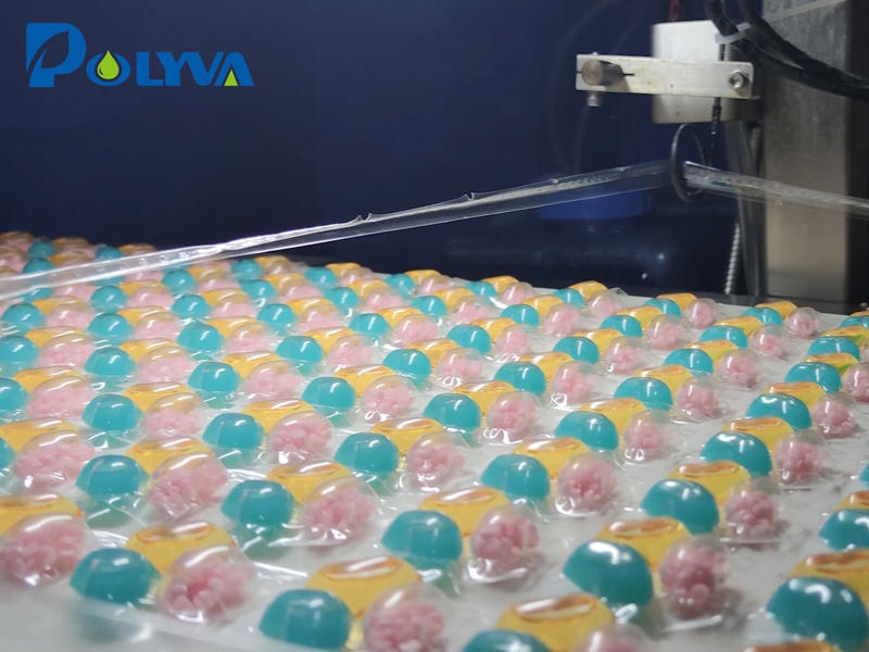 Polyva high-speed laundry pods packaging machine is producing new powder-liquid mixing cavity laundry capsules.This kind of mixed pods added with solid fragrance beads can achieve long-lasting fragrance after While cleaning clothes.